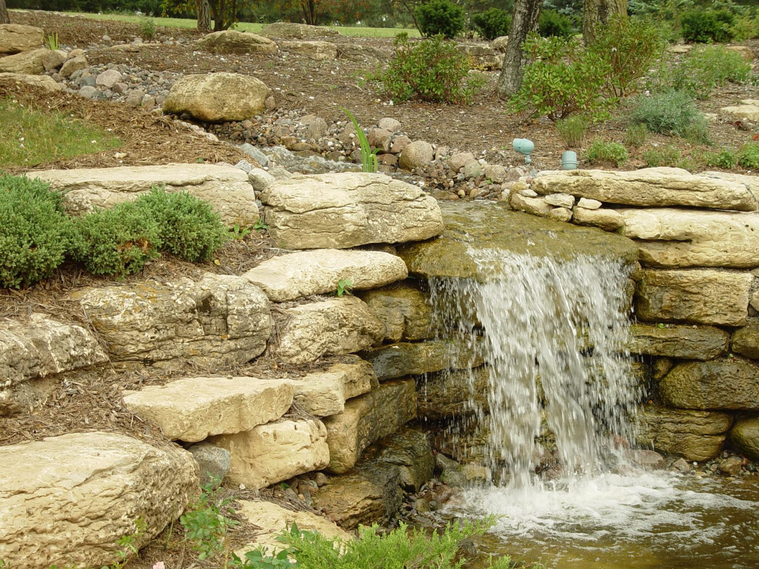 Stream, Waterfall, and Pond in a Client's Landscaping in Green Bay