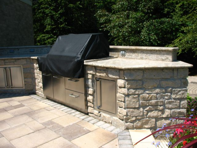 Outdoor Kitchen with Grill and Paver Patio in Pestigo
