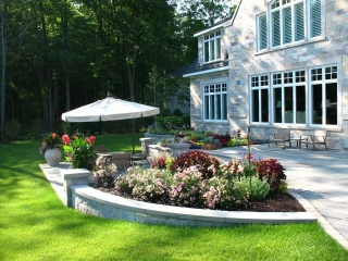 Season Color added around a Natural Stone Patio in Green Bay