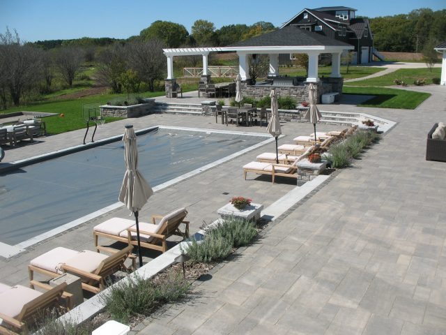 Outdoor Living Space complete with Pergola, Patio around a Pool, and Grill in Northeast Wisconsin