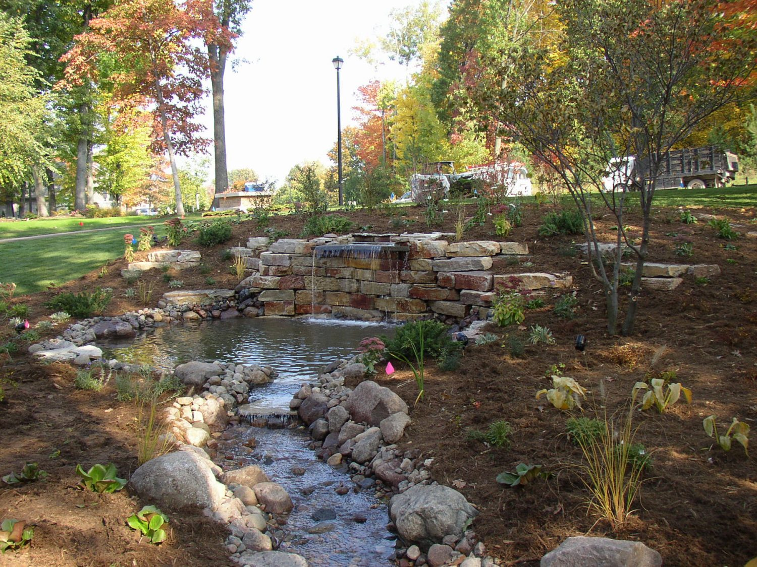 Waterfall, Pond, and Stream in a Landscape in Green Bay
