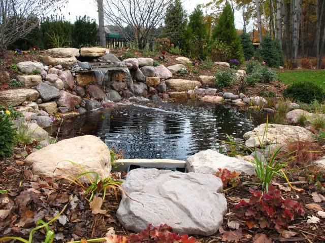 Waterfall and Pond in a Landscape Planting in Green Bay
