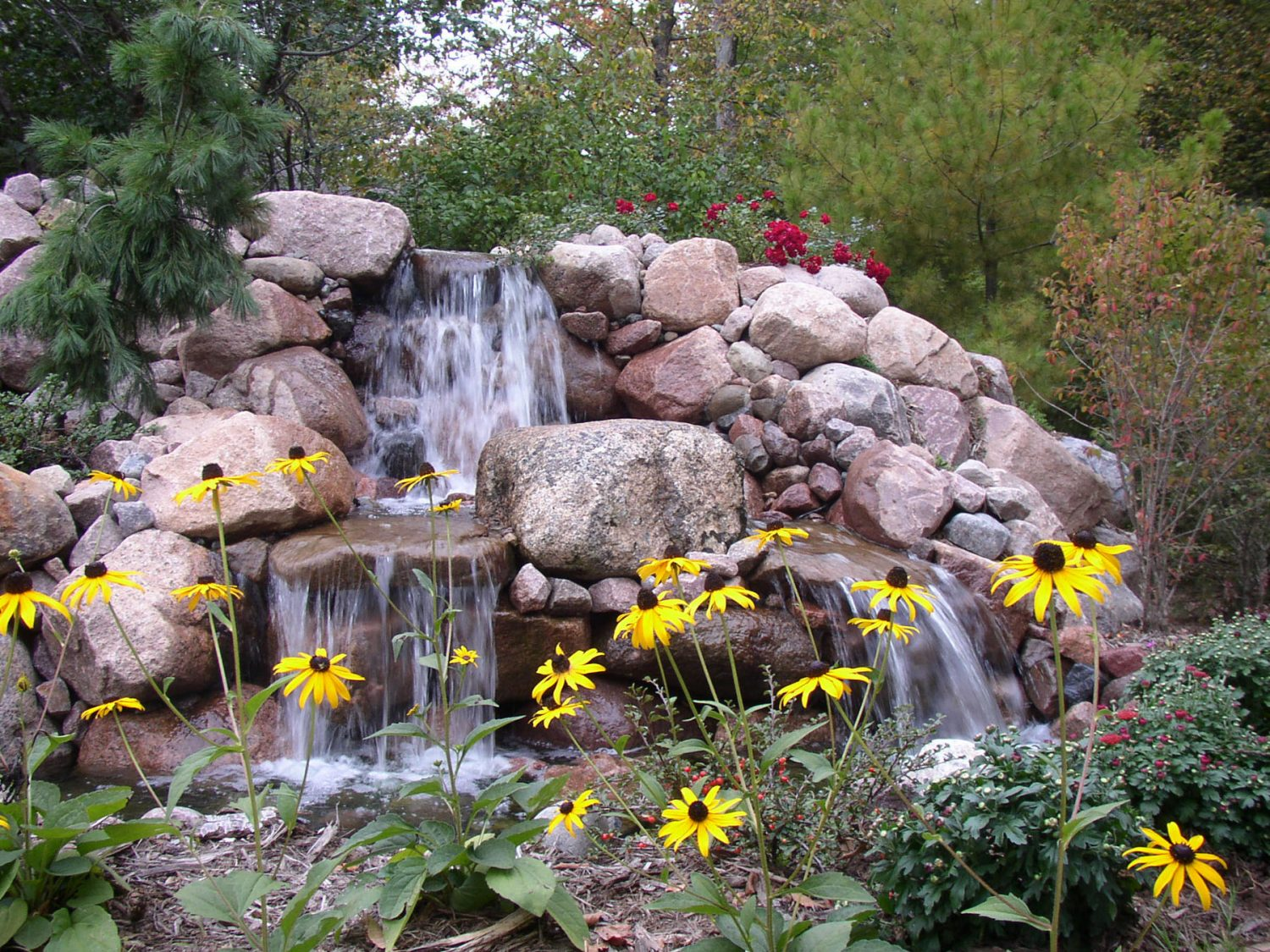Pondless Waterfall in a Landscape Planting in Green Bay