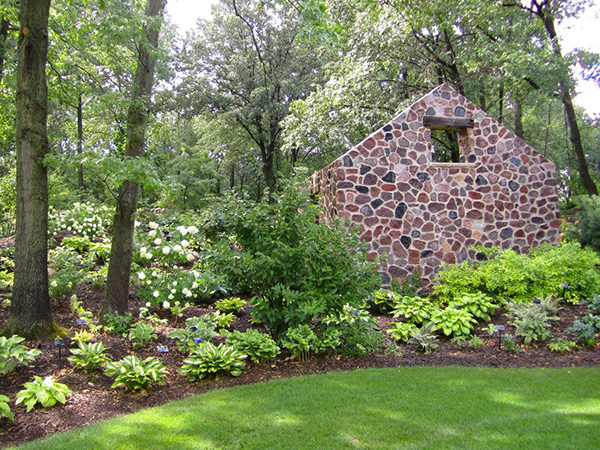 A stone house in the King Shade Garden construction at the Green Bay Botanical Gardens, built by Landscape Associates.
